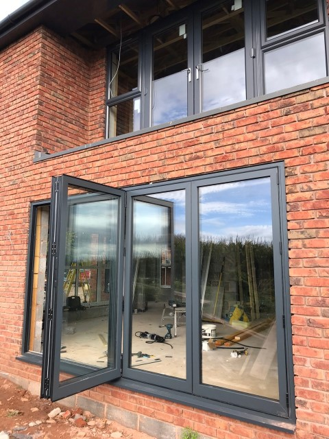 anthracite-grey-and-aluminium-bi3-Fold Doors